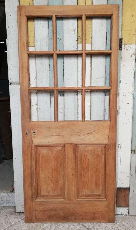 DB0670 A RECLAIMED TEAK INTERNAL / EXTERNAL DOOR WITH PANELS FOR GLASS
