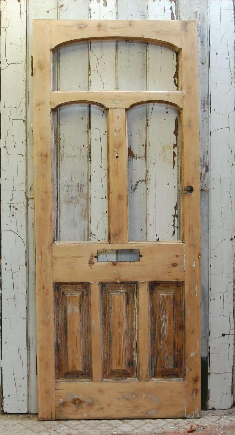 DE0849 A STRIPPED PINE VICTORIAN FRONT DOOR WITH PANELS FOR GLAZING