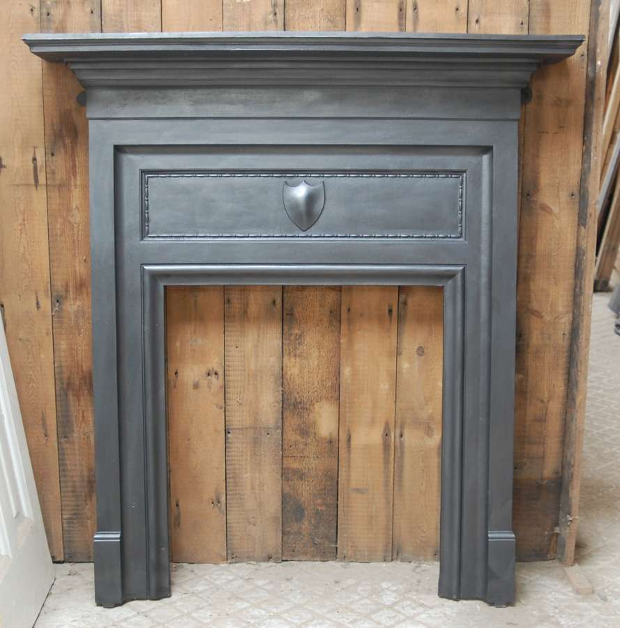 FS0115 A RECLAIMED EDWARDIAN CAST IRON FIRE SURROUND FOR WOODBURNER