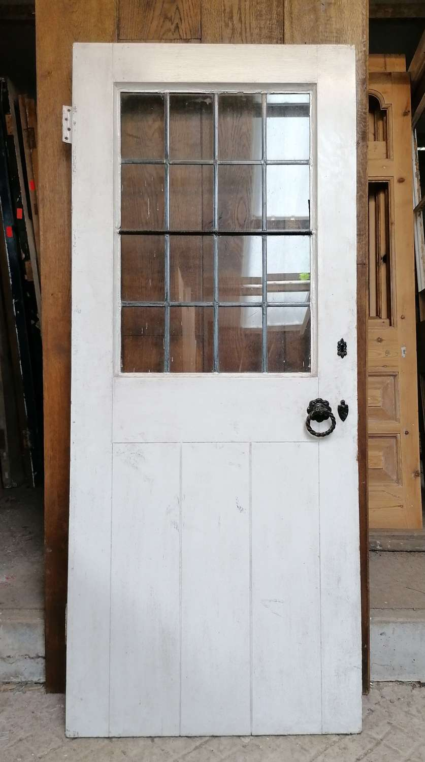DB0676 A SMALL RECLAIMED PINE COTTAGE DOOR WITH LEADED GLASS