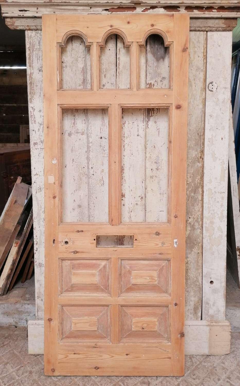 DE0858 AN ATTRACTIVE VICTORIAN PINE FRONT DOOR WITH PANELS FOR GLAZING