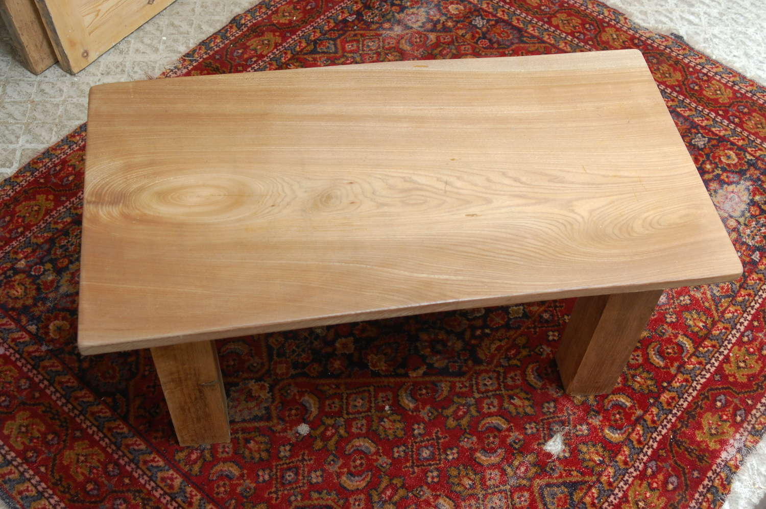 M1392 AN ELM AND OAK COFFEE TABLE MADE USING RECLAIMED TIMBER