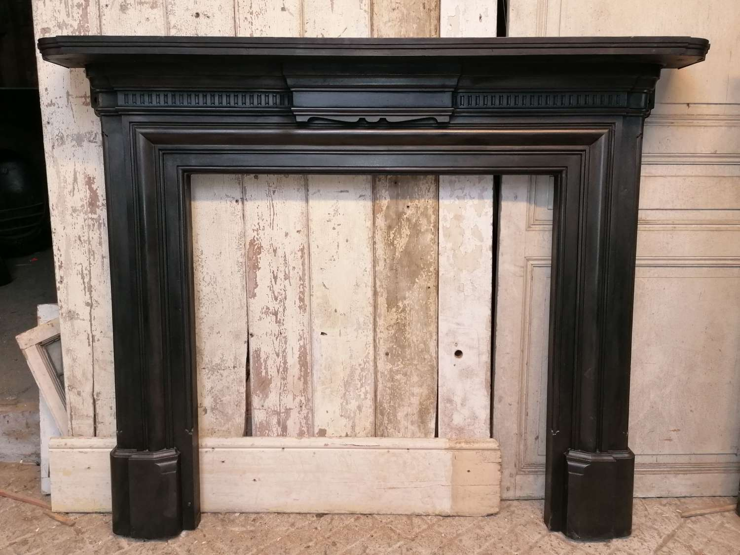 FS0120 A VERY LARGE ANTIQUE CAST IRON FIRE SURROUND FOR WOODBURNER