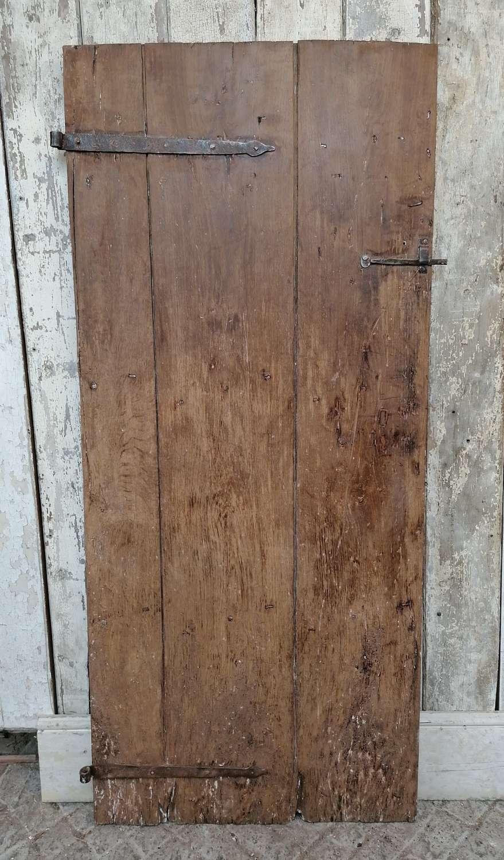 DI0718 A RECLAIMED ANTIQUE OAK PLANK DOOR FOR INTERNAL USE