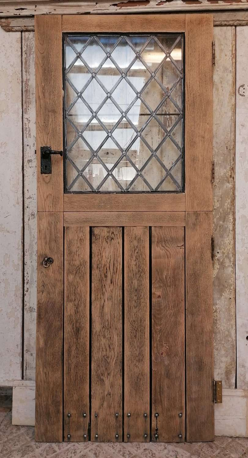 DB0679 A RECLAIMED OAK STABLE DOOR WITH LEADED GLASS