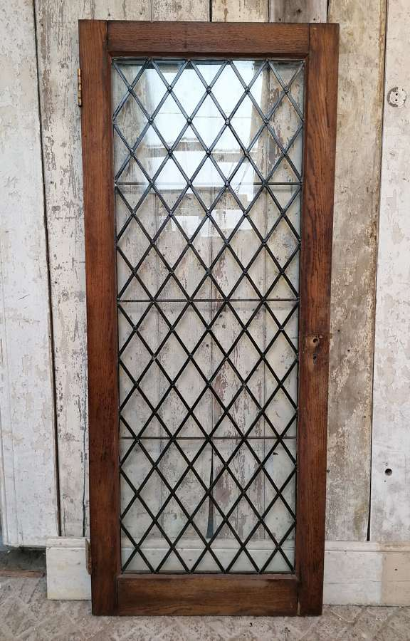 DB0678 AN ARTS AND CRAFTS GLAZED OAK INTERNAL / EXTERNAL DOOR