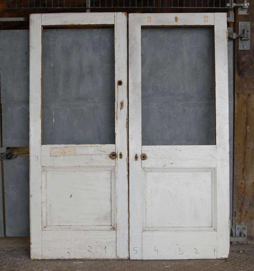 DP0297 A PAIR OF RECLAIMED NEO GEORGIAN PINE INTERNAL / EXTERNAL DOORS