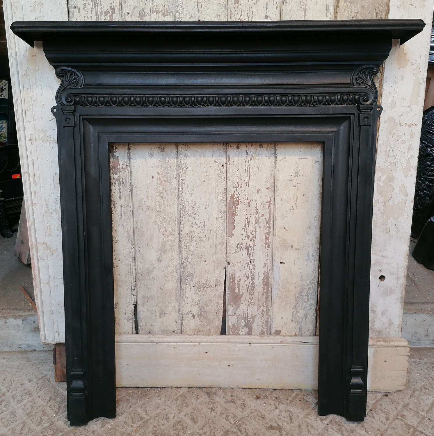 FS0130 A TALL ANTIQUE CAST IRON FIRE SURROUND FOR WOOD BURNER