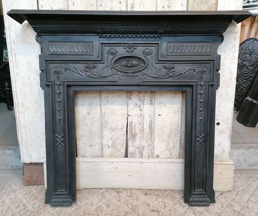 FS0129 A LARGE ANTIQUE CAST IRON FIRE SURROUND FOR WOOD BURNER