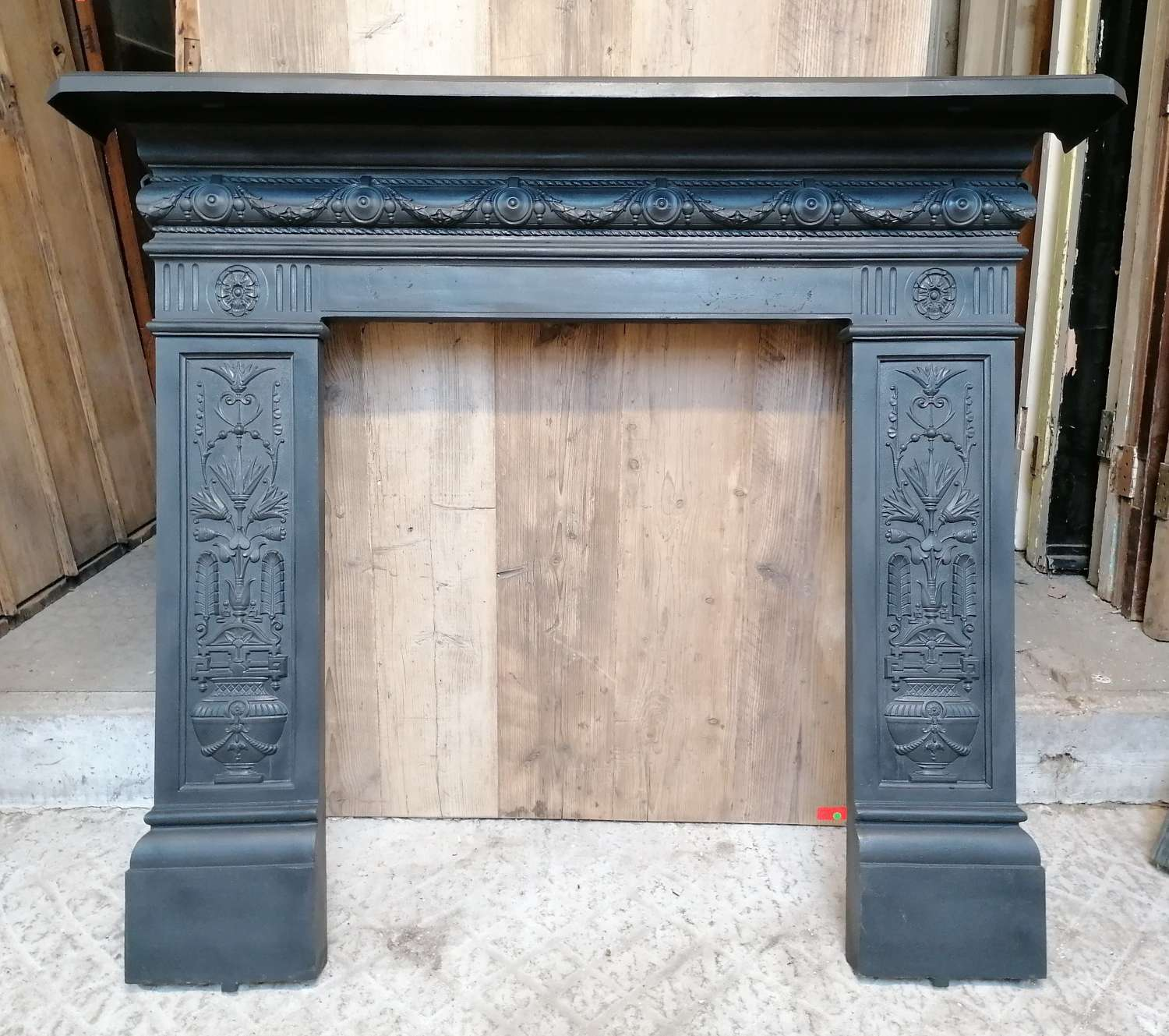 FS0128 LARGE RECLAIMED ANTIQUE CAST IRON FIRE SURROUND FOR WOOD BURNER