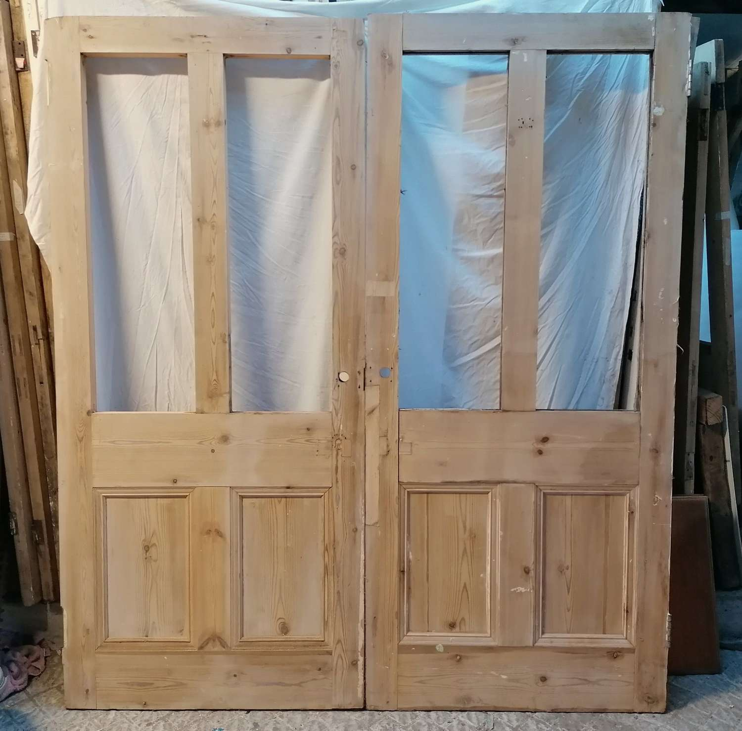 DP0299 A PAIR OF RECLAIMED STRIPPED PINE INTERNAL DOORS FOR GLAZING