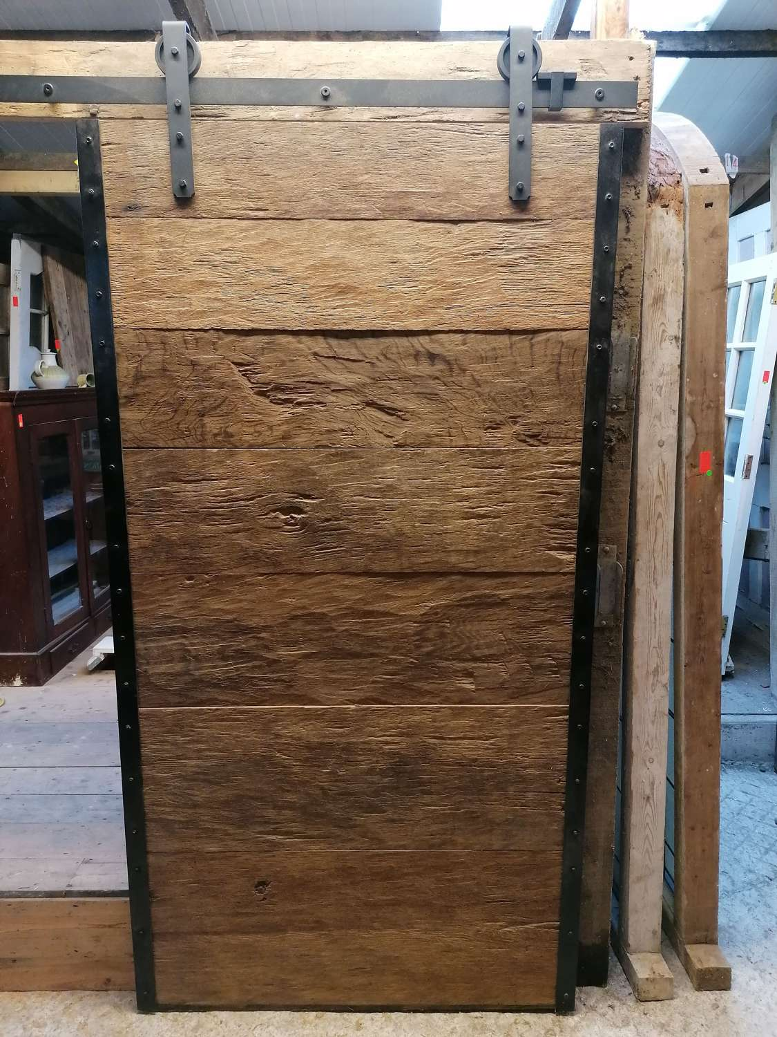 DI0734 AN INDUSTRIAL STYLE RUSTIC OAK SLIDING DOOR AND TRACK