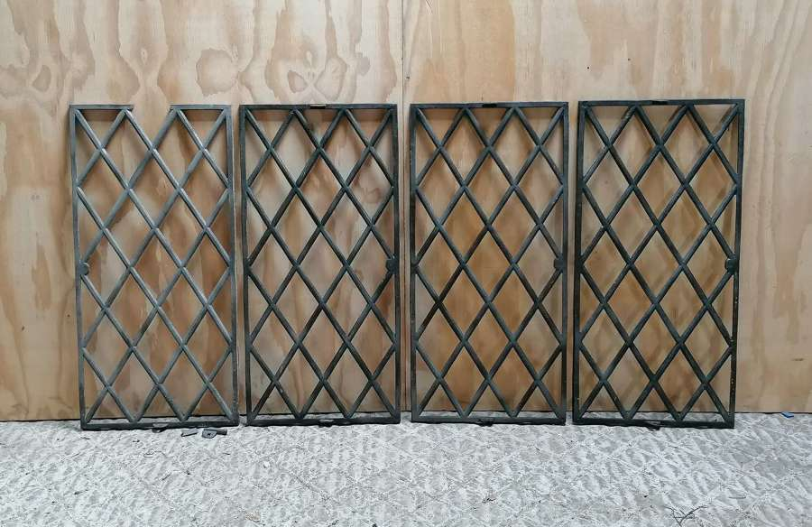 M1468 A SET OF FOUR RECLAIMED CAST IRON LATTICE WINDOWS FOR GLAZING