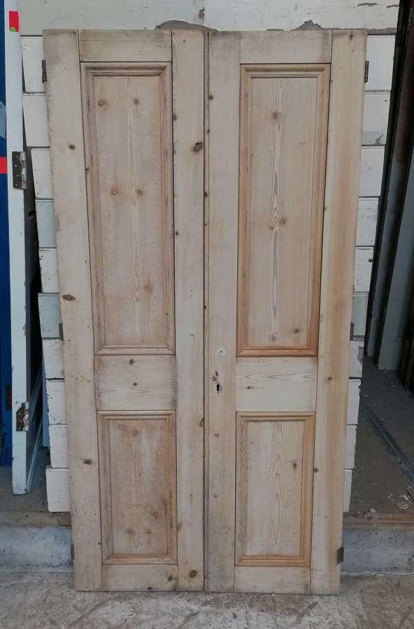 CS0041 A PAIR OF RECLAIMED STRIPPED PINE CUPBOARD DOORS C.1900