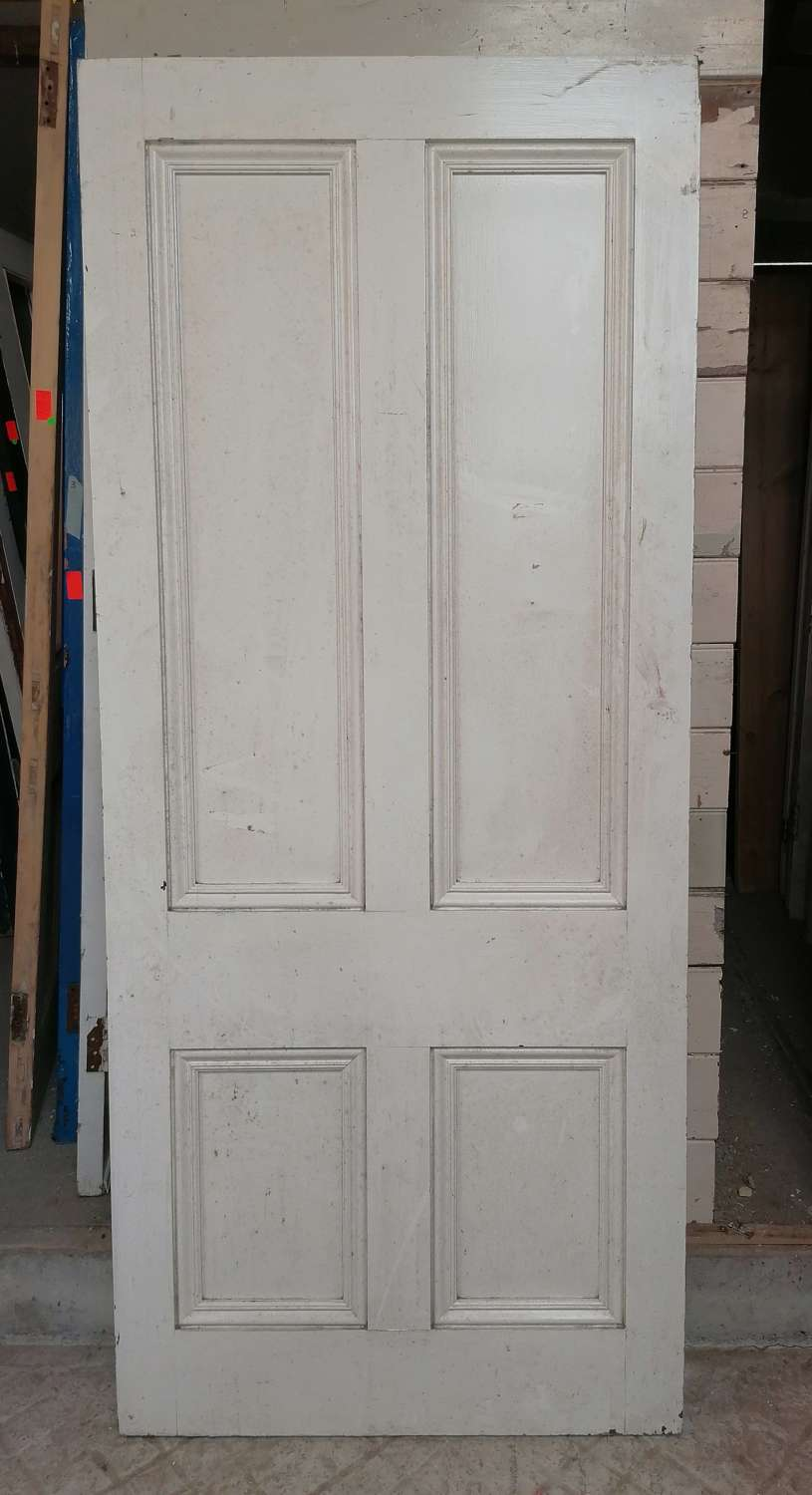DI0741 A LARGE RECLAIMED PAINTED PINE INTERNAL FOUR PANEL DOOR