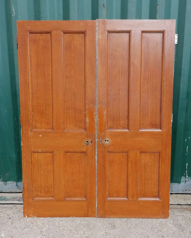 DP0321 A PAIR OF RECLAIMED 4 PANEL INTERNAL PINE DOORS