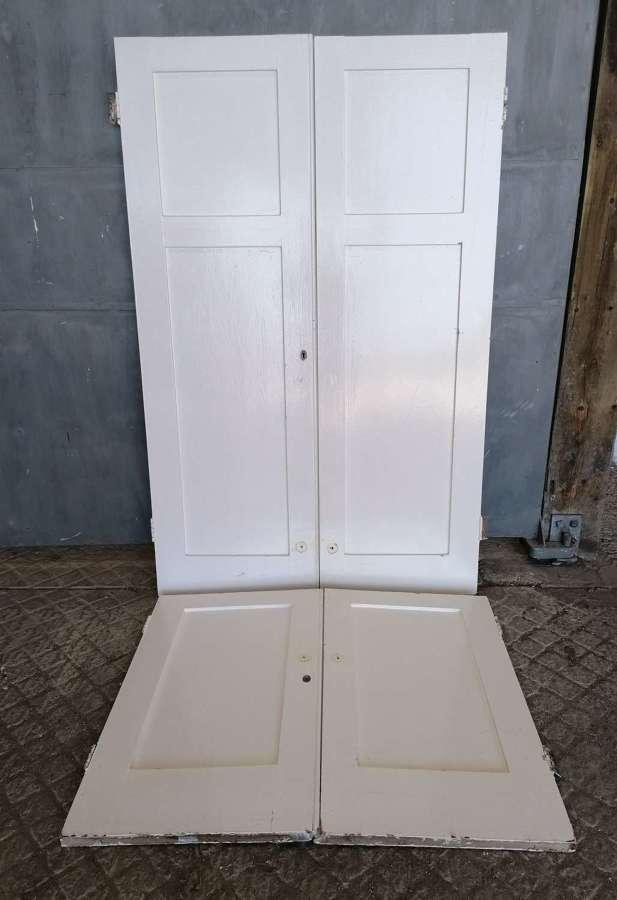 CS0050 A SET OF FOUR RECLAIMED PAINTED PINE PANTRY / CUPBOARD DOORS