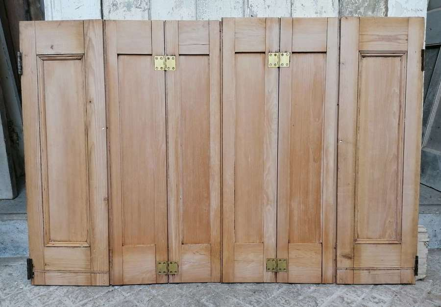 CS0054 A PAIR OF RECLAIMED STRIPPED PINE WAXED WINDOW SHUTTERS