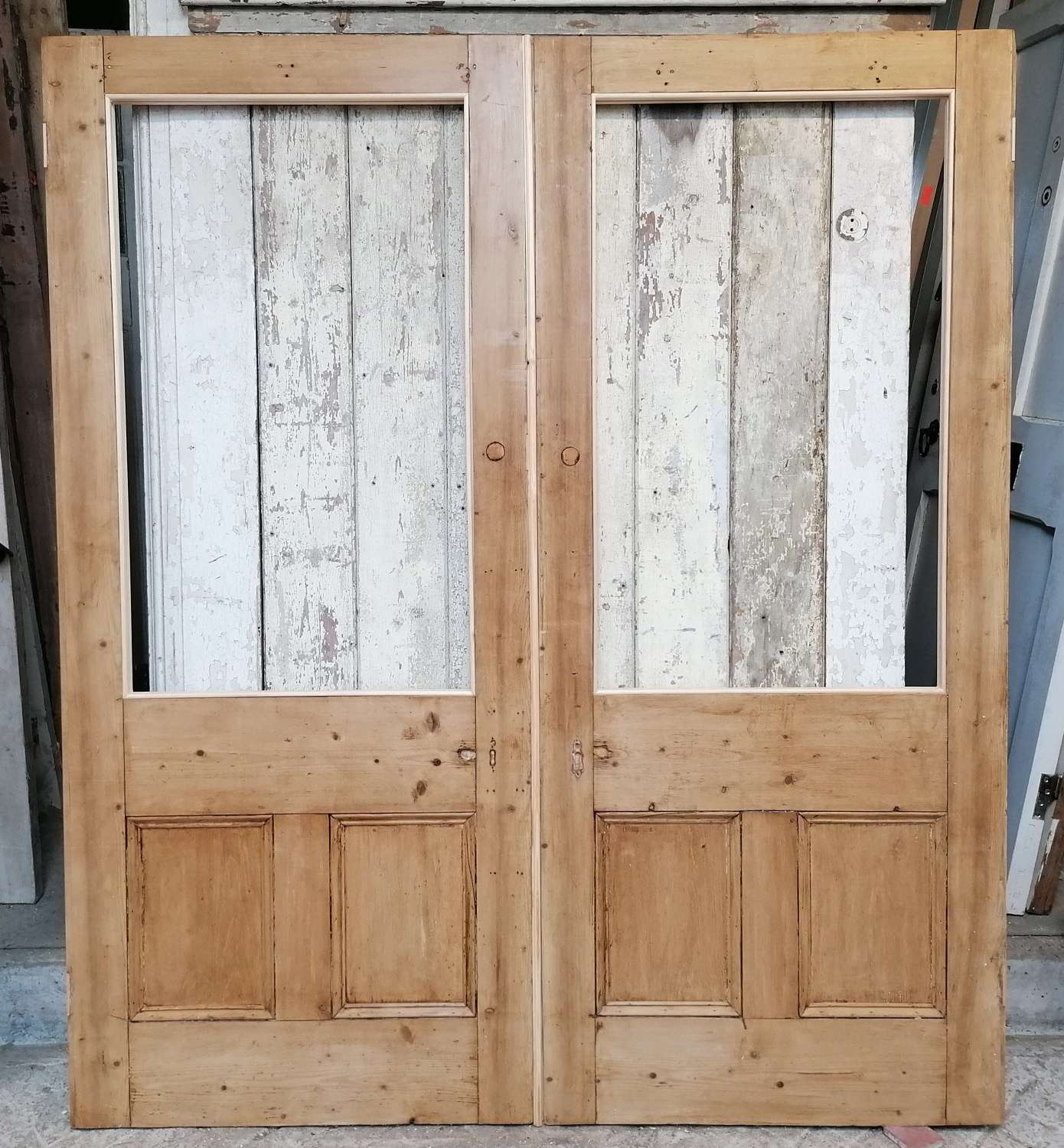 DP0329 A PAIR OF VICTORIAN INTERNAL STRIPPED PINE DOORS FOR GLAZING